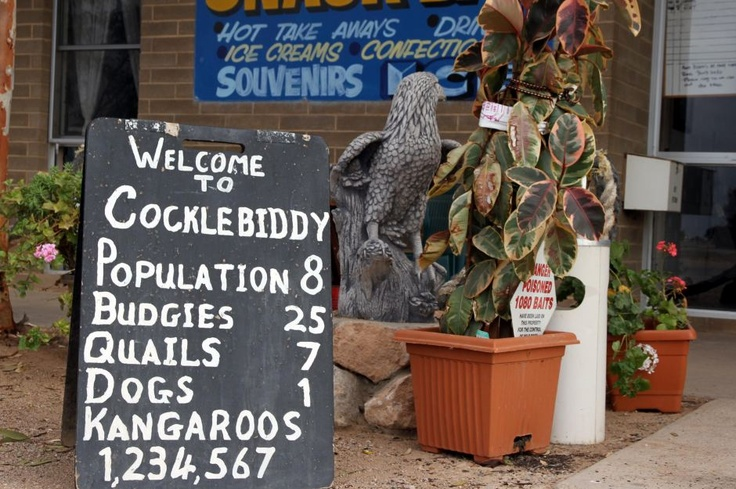Sign in Cocklebiddy Cocklebiddy is a small roadhouse community located on the Eyre Highway in Western Australia. It is the third stop east of Norseman on the long journey east across the Nullarbor Plain. The area is noted for its underground caves and lakes.