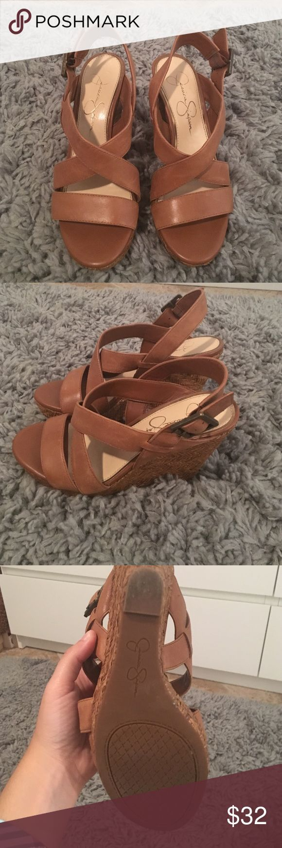 Barely worn Jessica Simpson wedges Beautiful barely worn Jessica Simpson wedges! Has a 4 inch wedge and adjustable straps. Brown leather on the straps and cork heels. Perfect for the summer :) extremely comfortable and no signs of wear. The bottom of the shoes barely look worn. Size 6 Jessica Simpson Shoes Wedges