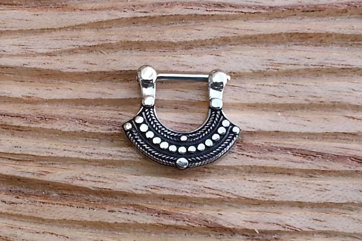 14g Septum Clicker by Flaming Bones This piece has been cast out of sterling silver and has an F-138 implant grade steel pin which goes through the piercing.