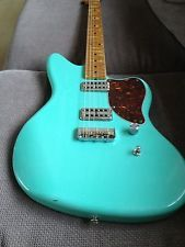 A guitar I found on Ebay, IMO somebody poured a whole vat of sexy over this guitar - Cabronita Jazzbronita relic, custom made TV Jones Filtertron Pickups, alder custom routed Jazzmaster body finished in sea foam green nitrocellulose lacquer, lightly relic'd, USA made Telecaster neck, Wilkson half Telecaster bridge, tortoise shell pickguard, relic'd Kluson tuners.