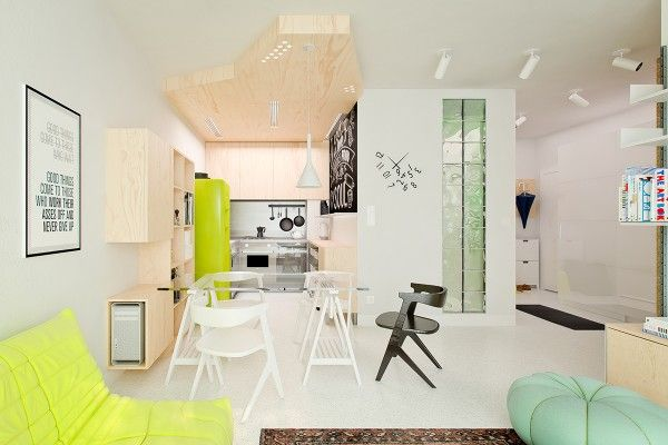 """The final apartment is from Poland and measures just 41 square meters (441 square feet). The space was also designed for a couple with their busy and mobile lifestyle in mind. Unlike many homes, it was not actually built """"to last."""" Instead, the permanent elements like the kitchen and bath were kept within a small budget so that money could be spent on high quality furniture."""