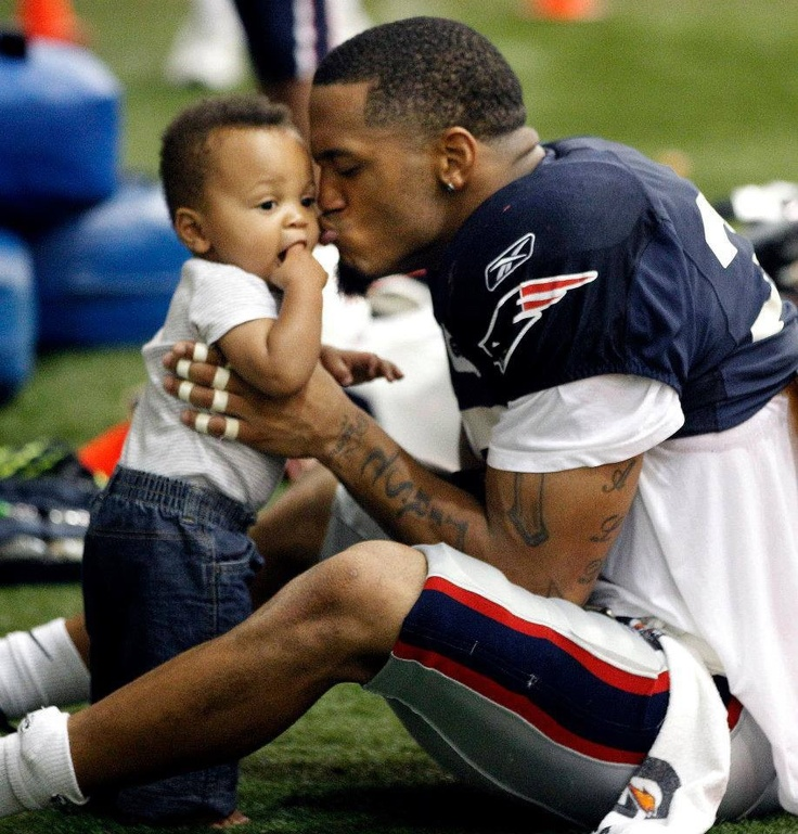 Former Patriot Patrick Chung And his adorable little boy. I love seeing men with their children. Especially big bad football players!