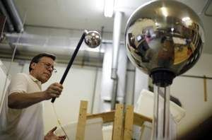 Bob Lazar, a physicist and owner of United Nuclear Scientific, demonstrates the classroom use of a Van de Graaff generator on July 17 in Owosso, Mich.