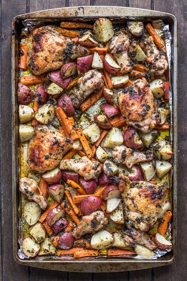 Make your entire dinner on a single sheet pan with this killer Pesto Chicken with Potatoes and Carrots.