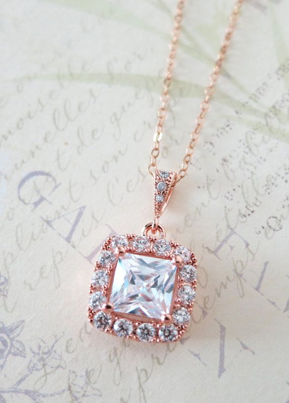 Rose Gold necklace with a luxe halo style Clear Square Cubic Zirconia drop. ✦ Cubic zirconia pendant: Rhodium plated, 0.6 inch ✦ Length: 16.5 inch +