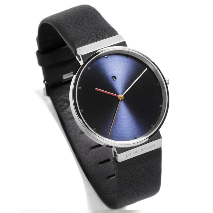 The 800 series 841 watch by Jacob Jensen is minimalism at its best. This ultra thin watch sits comfortably on the wrist and has a simple display that is typical of the Jacob Jensen design studio. Features: Brushed charcoal face Glossy silver, bronze and gold hands Brushed blue dial Date
