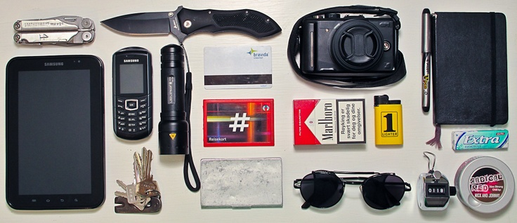 Every Day Carry: Leatherman, Samsung Galaxy Tab, folding knife, Samsung GT-E2370, LED Lenser T7, keychain with mini crowbar, access card, buss pass, card holder, camera, Marlboro, lighter, sunglasses, Moleskine and pen, chewing gum, hand counter, snus.