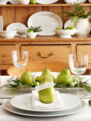 Thanks to a pearl-topped pin, ripe pears serve as edible name-card holders. Pears also appear, with greenery and tiny ornaments, in a DIY-on-a-dime centerpiece. #christmas #holiday #crafts