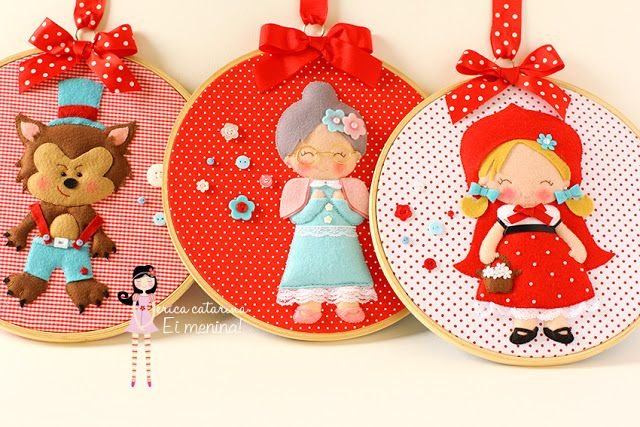 cute way to make a felt ornament or wall hanging - picture mounted in embroidery hoop, with added bow and loop