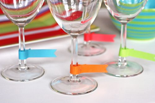 Use washi tape tags to label them. | 24 Clever Things To Do With Wine Glasses
