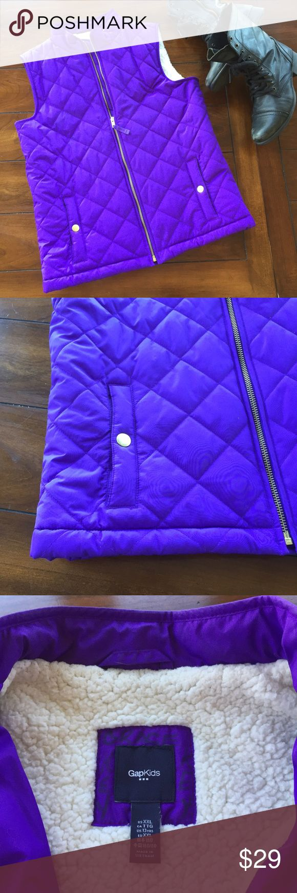 GAP GIRL'S DOWN WITH SHEARLING VEST EUC XXL GAP girl's vest that is so adorable. Purple with gold zip pockets. Zip closure with faux shearling lining. It's in EUC. Worn a couple of times. Looks like new. XXL (14/16) this is an XXL  not an XL. Posh has an error. When I edit it clicks XXL but it posts as XL I have notified support. It would easily fit a ladies Small as well GAP Jackets & Coats Vests