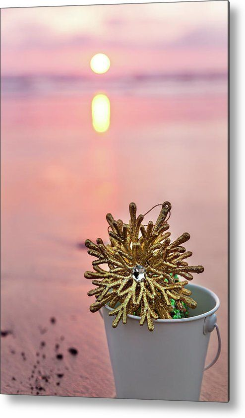 Metal Print featuring the photograph Golden Snowflake by Evgeniya Lystsova. Golden Snowflake in a white bucket at sunset on the background of beach and sea, holiday concept.  Bring your artwork to life with the stylish lines and added depth of a metal print.  Available as canvas, framed and wood prints as well. Lovely Christmas Decor for your Bath and Bedroom. #EvgeniyaLystsovaFineArtPhotography #Snowflake #Sunset #Pink #HomeDecor #Gift #Prints