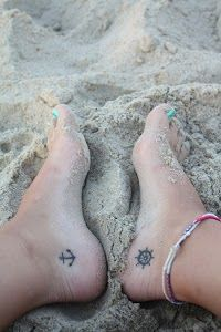 Anchor and ship steering tattoo on feet