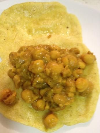 Trini Doubles: Caribbean Fried Dough and Chickpea Sandwiches.  Top it with hot sauce and a mango chutney.  Note:  Add jerk chicken for a complete meal. Mango chutney:  http://www.foodnetwork.com/recipes/alton-brown/mango-chutney-recipe/index.html