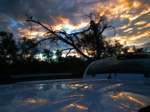 A Karoo Sunset reflecting on the car's roof