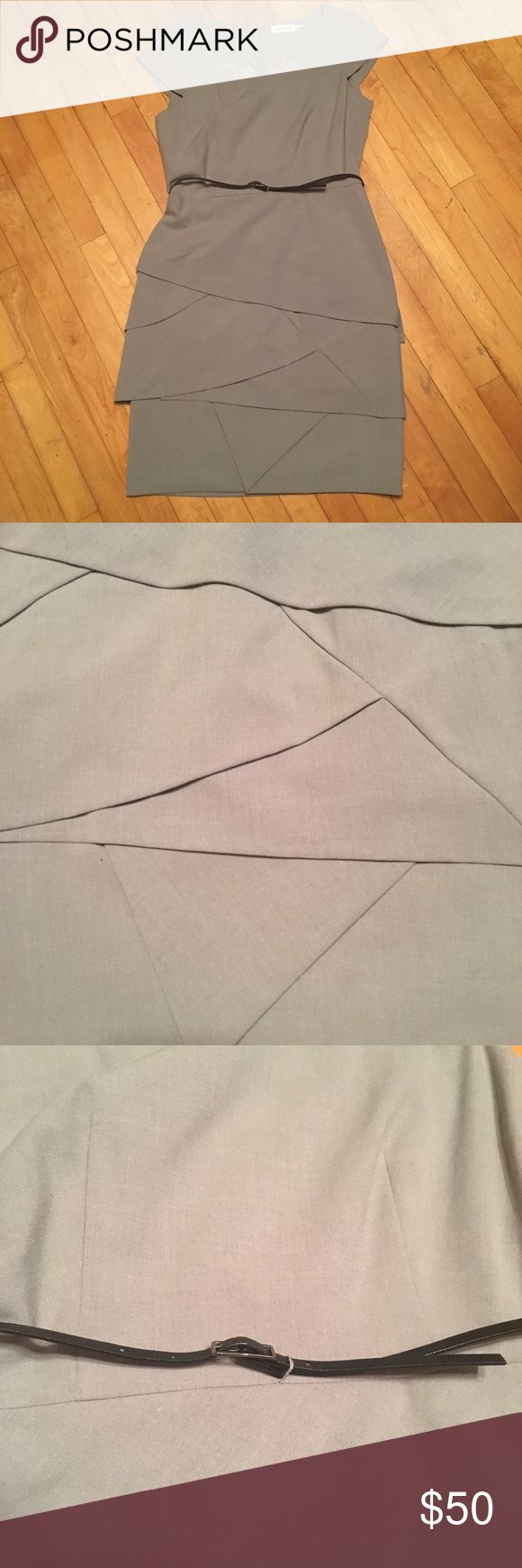 Beautiful artichoke skirt Calvin Klein dress Lovely grey dress with artichoke (asymmetrical tiered) hemline skirt and black skinny belt. Top is sleeveless. Size is 10. Little to no stretch. Calvin Klein Dresses Asymmetrical