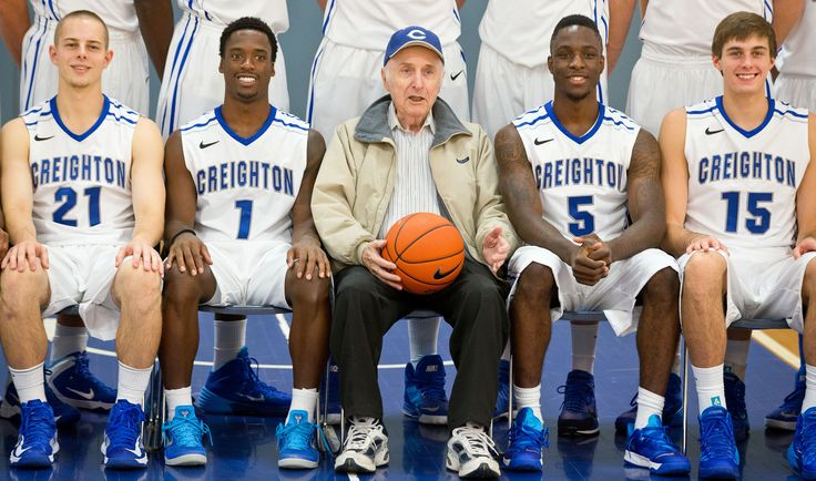 From left: Isaiah Zierden, Austin Chatman, Dick Upah, Devin Brooks and Darian Harris pose for a photo at media day at the Vinardi Athletic Center on Thursday, October 17, 2013. Head Coach Greg McDermott had got up and asked super fan Upah to take his place for a photo. By: CHRIS MACHIAN/THE WORLD-HERALD