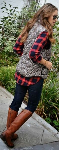 Love the plaid shirt and the vest with the leggings. Might wear shorter boots with this though.