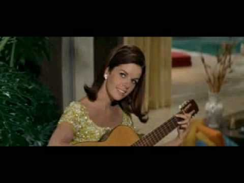 Michele Monet (Claudine Longet) sings a strangely hypnotic song in the 1968 Peter Sellers movie, The Party (directed by Blake Edward).