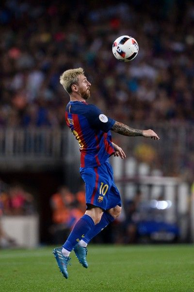 Barcelona's Argentinian forward Lionel Messi controls the ball during the second…