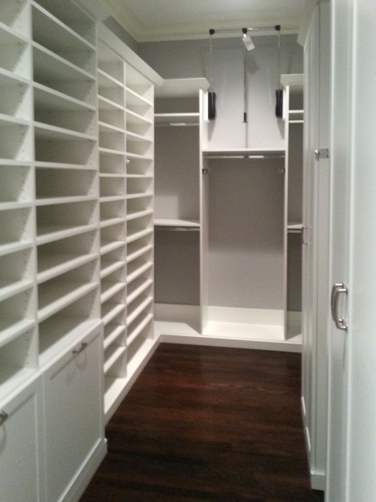 lots of shelving for shoes a pull down rod to utilize the high ceiling and tilt out laundry hampers for more space saving ideas