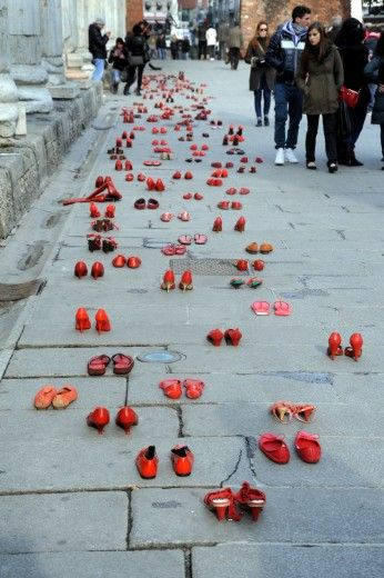 Hundreds of red shoes in Milan to protest against violence on women.