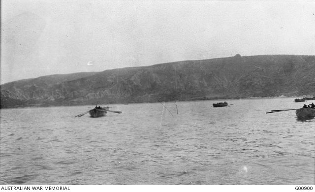 Troops of the 1st Brigade row to the beach and empty boats return from the shore to the destroyers at about 9.45 a.m., on the morning of the Australians landing at Anzac Cove. Those landed in the morning first rushed the small outstanding plateau, afterwards called Plugge's Plateau and then went over the skyline into Shrapnel Valley.