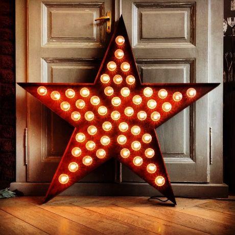 Fairground star light illuminated wedding decorations