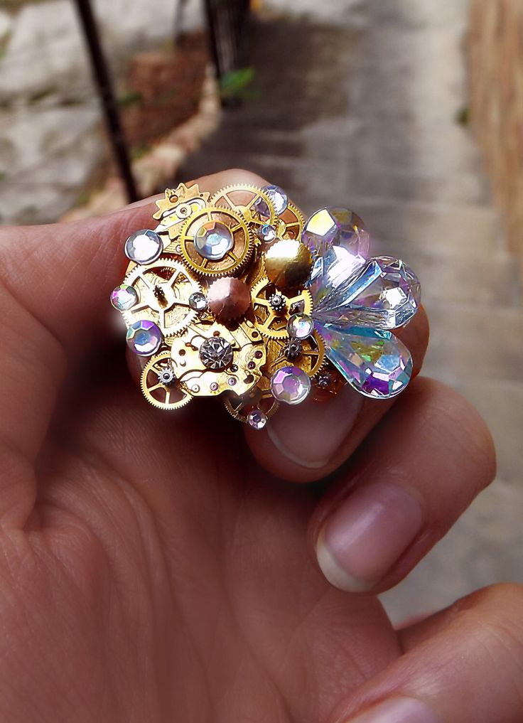 Steampunk ring, gold steampunk ring, ab crystal ring, rainbow ring, crystal ring, steampunk art, watch gear ring, filigree ring, OOAK by CindersJewelryDesign on Etsy https://www.etsy.com/listing/231884237/steampunk-ring-gold-steampunk-ring-ab