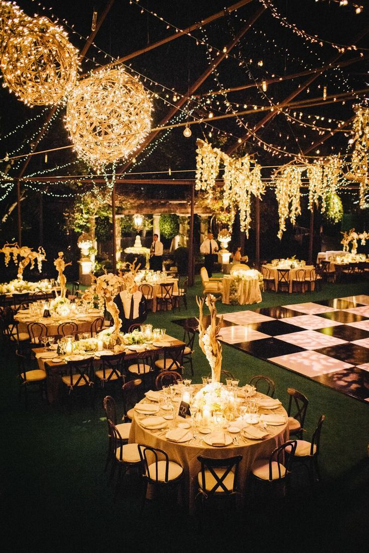 Create a modern day Great Gatsby wedding with this wedding venue inspiration. The decorative lights and checkered dance floor will have your guests in awe from the moment they walk inside. #greatgastbywedding #vintagewedding #weddingvenue #weddingtheme