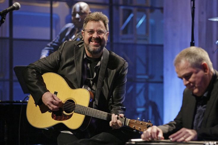 "He may be preaching ""Don't Rush"" with Kelly Clarkson, but current GRAMMY nominee Vince Gill is quick to smile during a performance on ""The Tonight Show With Jay Leno"" on Jan. 9 in Burbank, Calif.: Vince Gill, Kelly Clarkson, Jay Leno, Current Grammy, Nominee Vince, Photo"
