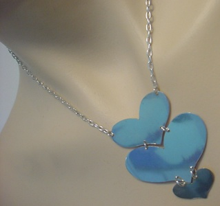 Sterling silver menage-a-trois necklace.