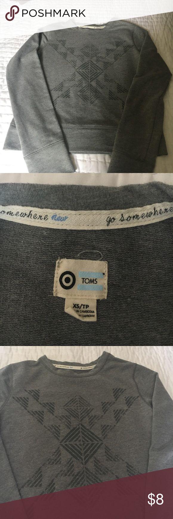 TOMS sweatshirt Gray TOMS sweatshirt. Heather gray with a darker gray Aztec front design. Light weight and cute and classic. TOMS Tops Sweatshirts & Hoodies