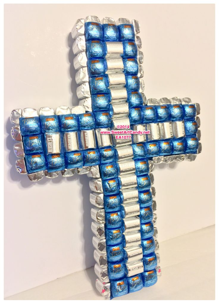 A blissful cross created with Hershey's Bliss and Hershey's Nuggets. A sweet gift for a baby blessing, baptism, or Sunday dinner. This candy art sculpture can be customized with your choice of colors.