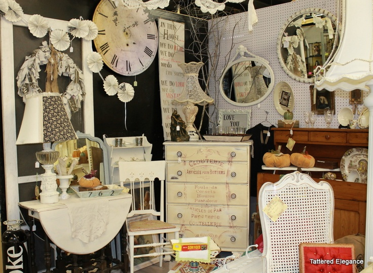 Black wall in antique mall booth display! ~ www.tatteredelegance.blogspot.com