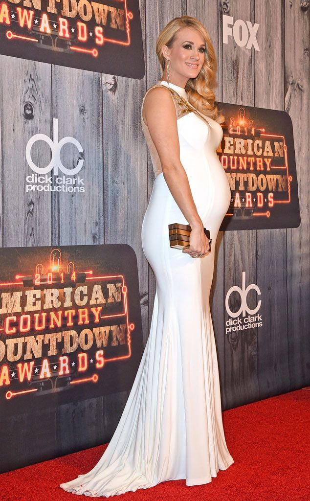 CARRIE UNDERWOOD White hot! The singer flaunted her growing bump at the American Country Countdown Awards.