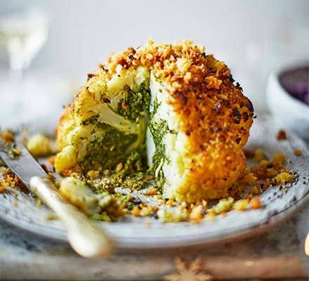 Need an alternative to nut roast for veggies and vegans on Christmas Day? Try this festive and filling cauliflower roast stuffed with kale and chestnuts