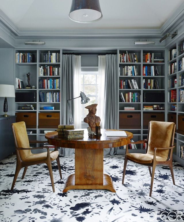 Vladimir Kagan armchairs, pendant fixture by Chris Lehrecke, 1930s walnut table is Italian, and the custom carpet is by Kelly Wearstler. design by Candace Shaw   - ELLEDecor.com