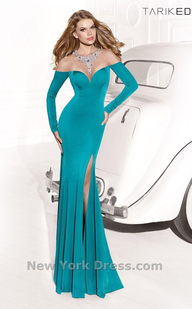 Brilliant bijoux embellish this bella evening gown by Tarik Ediz 92377. The sparkling necklace trims the sheer illusion neckline with dazzling detail. Full-length,