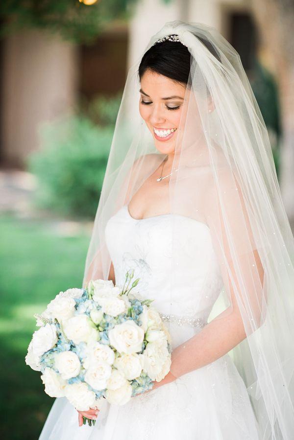 Classic wedding dress for a Disney wedding | Elegant Disney Wedding at Four Seasons Hotel Silicon Valley | Annie Hall Photography | See more on My Hotel Wedding: https://www.myhotelwedding.com/blog/2016/04/11/elegant-disney-wedding-at-four-seasons-hotel-silicon-valley/