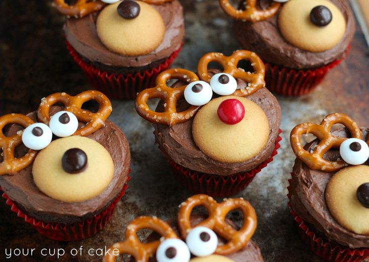 reindeer cupcakes: chocolate cupcakes with vanilla wafers, red hot, pretzels, and eyes.