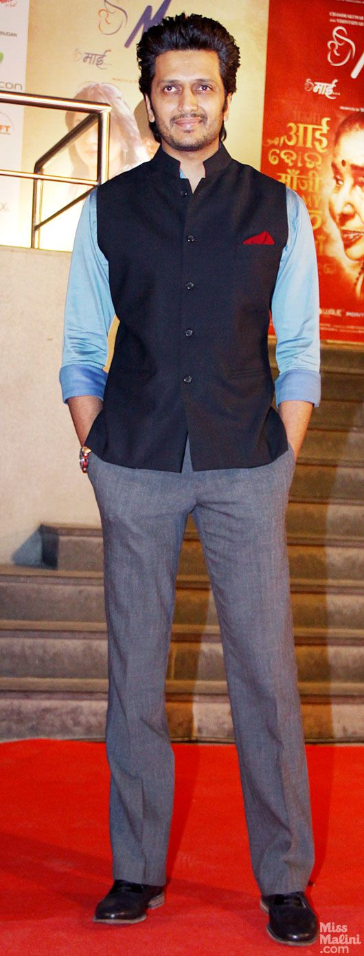 Riteish Deshmukh wearing a dark navy Neru waist coast with a light blue shirt and grey trousers