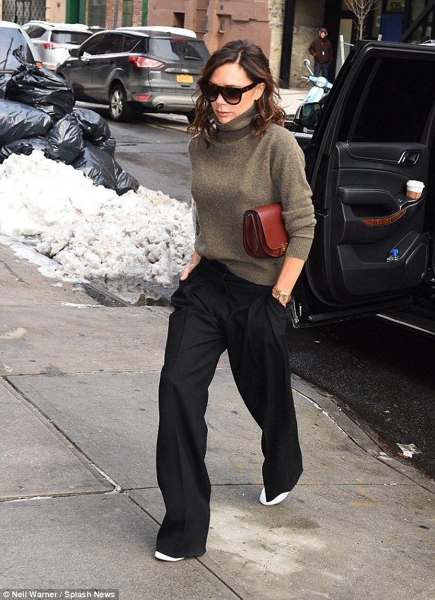 No moss-ing around! Victoria Beckham continued to keep her head held high as she stepped o...