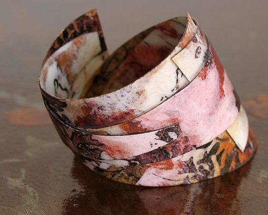 Patterned Cuff Bracelet by all things paper, made from paper than brushed with a polymer glaze. (Golden Polymer Emulsion)