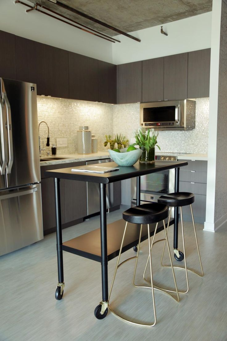 sleek polished surfaces and strong geometric shapes create a streamlined modern kitchen