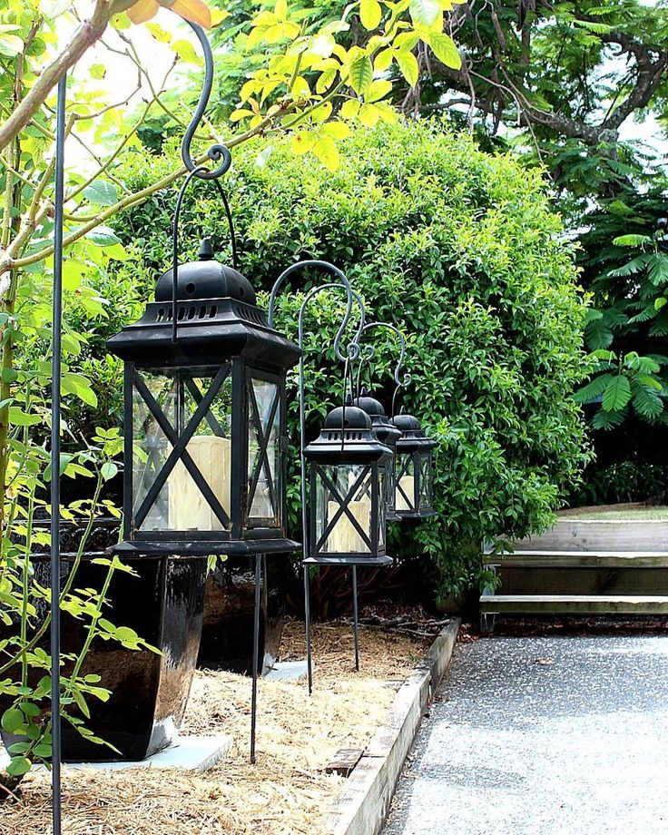 You know I have a thing for lanterns! This row of lanterns hang from shepherd's hooks and light the way to the back stairs.