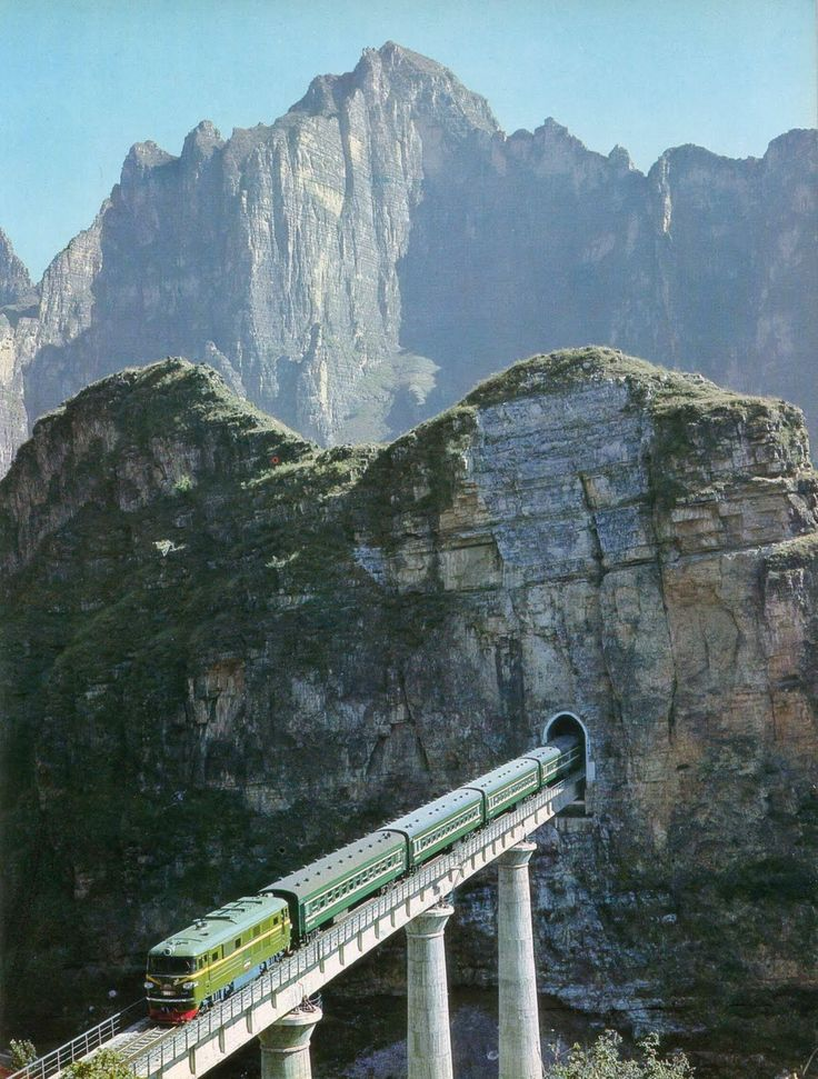 Train through the mountains. A new railway line built through the precipitous region of southwestern Fangshan County, one of Beijings outlying districts that abounds in peaks and canyons.