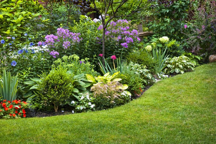 A varied plant border provides a layered look that impresses year-round. Choosing the right plants is key. A few deciduous trees and shrubs maintain the green. A mix of flowers, blooming bushes and variegated plants can keep the color going through three seasons  47 Amazing Backyard Landscaping Ideas | InteriorCharm