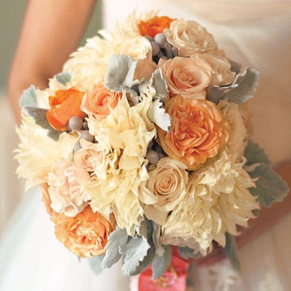 White dahlias, silver brunia, coral peonies, spray roses, and Versilia roses.