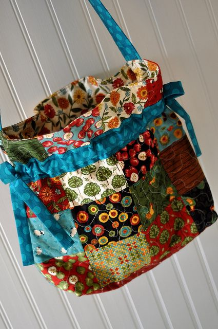 Drawstring bag with handle made with scraps.